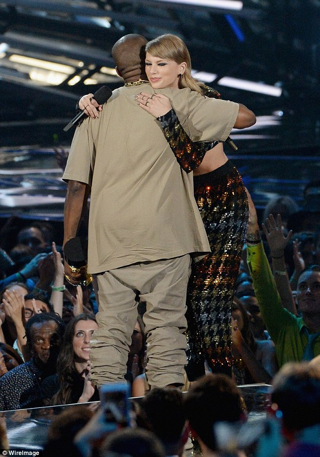 2BD377A700000578-0-Kanye_and_Taylor_Swift_embraced_on_stage_after_she_finished_her_-a-98_1441017248316
